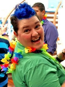 Romaine Patterson having fun on a DNR Cruise, wearing a lei.